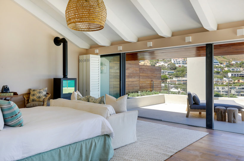 Master bedroom with wood burning fireplace - Cape Concierge - Cape Town Luxury Accommodation
